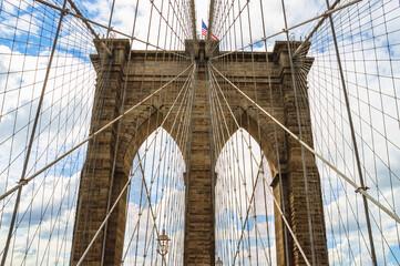 Skyward view of the famous Brooklyn Bridge in New York city Fotobehang