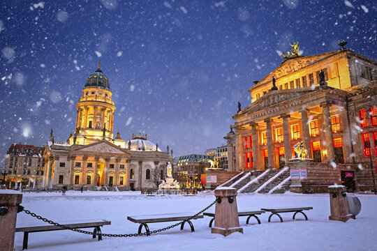 Snowy illuminated Gendarmenmarkt at night in Berlin, Germany