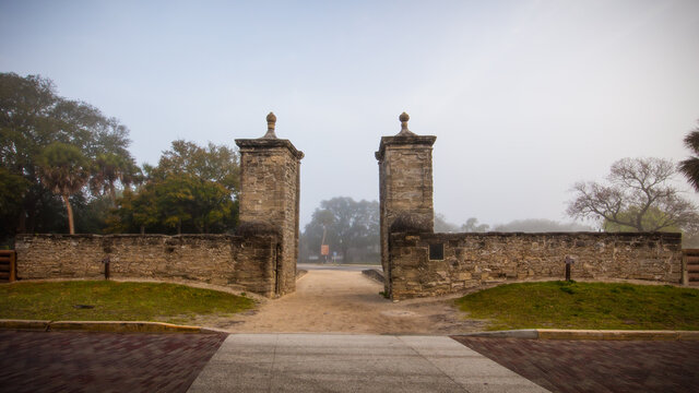 Old city gates at the north end of St. George Street in St. Augustine, FL.  Constructed 1808.  Morning lit through fog.