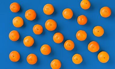 Fruit pattern of fresh orange tangerine or mandarin on blue background. Flat lay, top view. Pop art...
