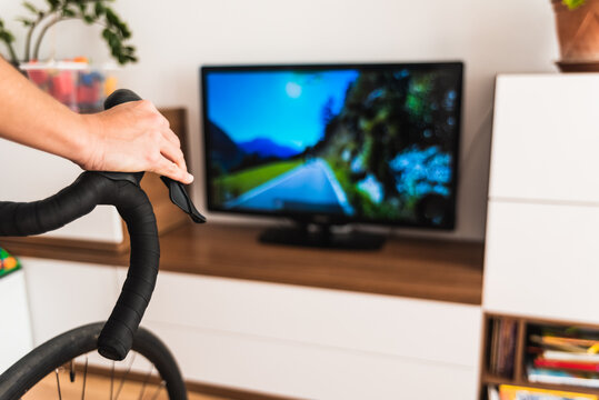 Woman exercises indoors using her bike for a virtual race.