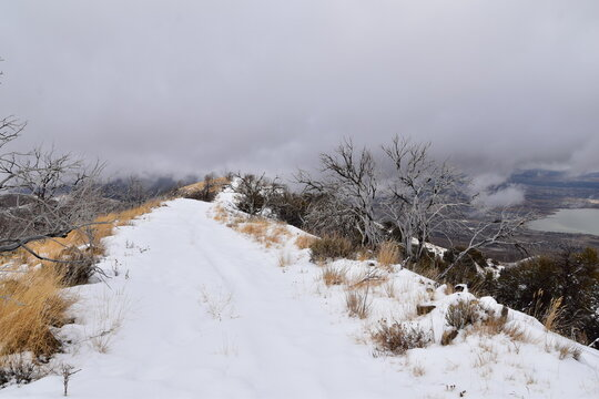 Snowy Hiking Trail views towards Lake Mountains Peak via Israel Canyon road towards Radio Towers in winter, Utah Lake, Wasatch Front Rocky Mountains, Provo, United States.