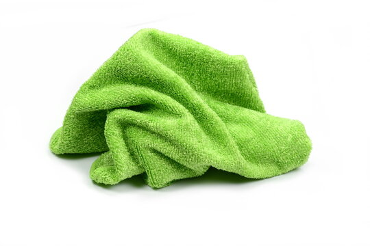 Green micro fiber towel isolated on white background. Clean, new green microfiber cloth isolated on white background