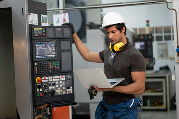 Obraz Worker factory man concept. Inspection technician, factory engineer, inspection of the machine condition in the factory. Inspection by technicians, industrial business, production machinery - fototapety do salonu