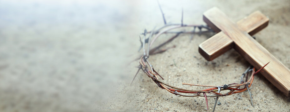 Passion Of Jesus Christ. Crown of thorns and wooden cross on sand, banner design