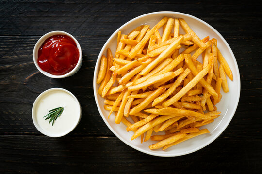 French fries with sour cream and ketchup