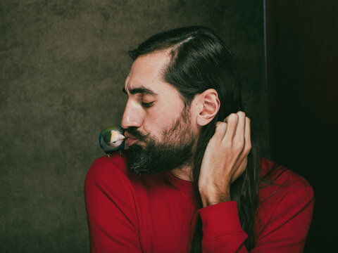 adult, animal, attractive, background, beard, bearded, beautiful, beauty, bird, birds, brutal, business, casual, caucasian, closeup, color, colorful, confident, cute, dramatic, eating, face, fashion,