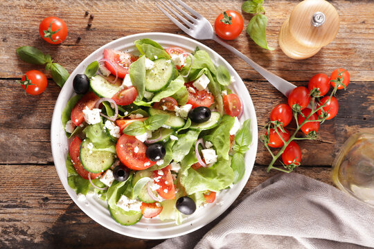 vegetable salad with cucumber, tomato and cheese