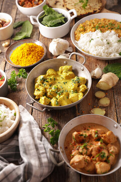 indian food selection- curry meal, chicken, pita bread