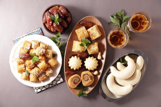 traditional arabic dessert baklava, dates, mint tea
