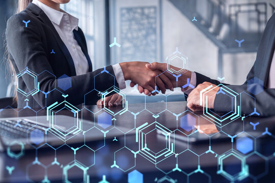 Handshake of two businesspeople as agreement concept to develop a new software to improve service at a company. Technological icons. Woman in business.