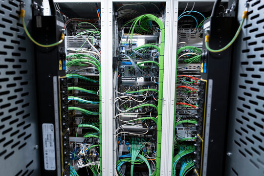 Close up view of internet equipment and cables in the server room. Broadcast system room.