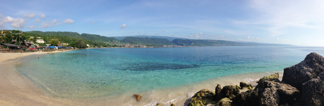 view of the sea and mountains. Beautiful view at Kilo Lima Beach Luwuk Central Sulawesi Indonesia