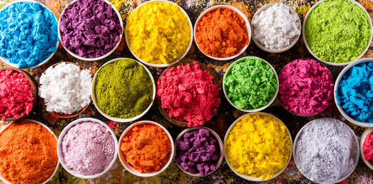 Happy Holi decoration, the indian festival.Top view of colorful holi powder on dark background.