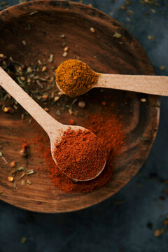 spoon of red curry powder and regular curry powder