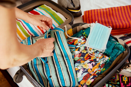 man packing his holidays suitcase