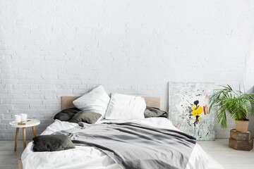 Fototapeta Interior of bedroom with plant and paintings obraz