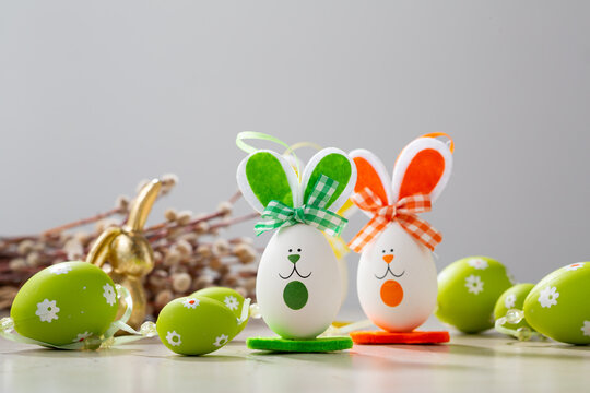 Funny Easter bunny and green eggs