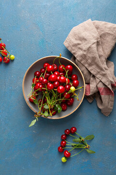 Overhead view of Fresh sour cherries in bowl, summer fruits