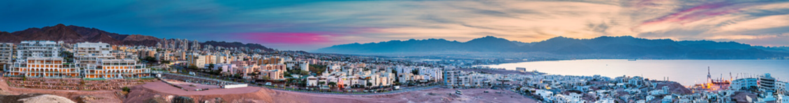 Aerial scenic panorama of the Red Sea, mountains and buildings of Eilat city - famous tourist resort and recreational place in Israel
