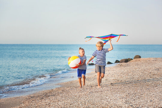 Happy children having fun at the beach. Active kids on summer background.