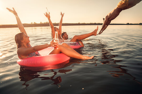 Friends enjoying a summer day swimming at the lake.