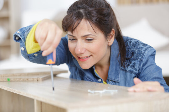 a woman doing diy works at home
