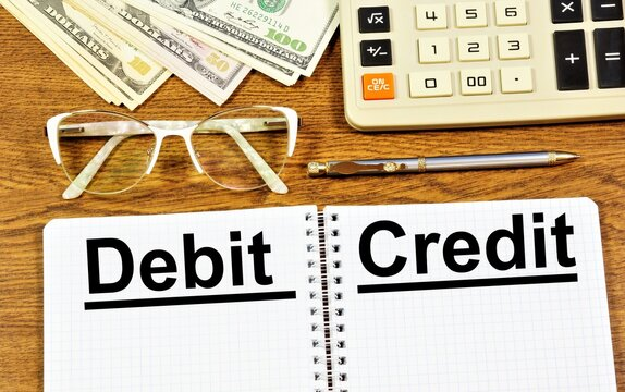 Debit credit. Text label in the working document. Standard accounting methods.