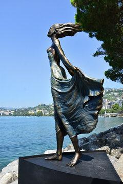 Montreux, Switzerland- August 24, 2019. Woman sculpture on Leman (Geneva) lakeshore, Montreux Riviera, Switzerland