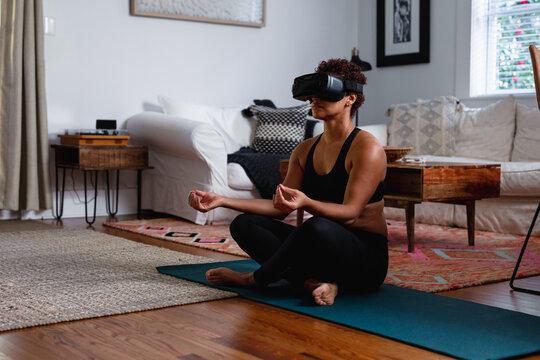 Black woman does meditation virtual reality exercise