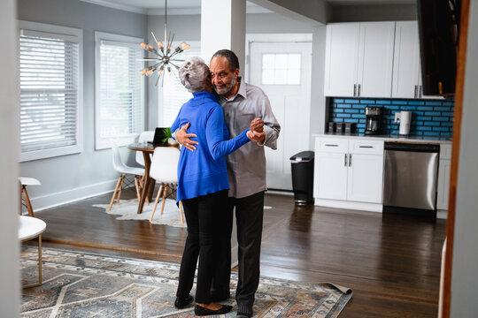 Active lifestyle, senior couple dances at home