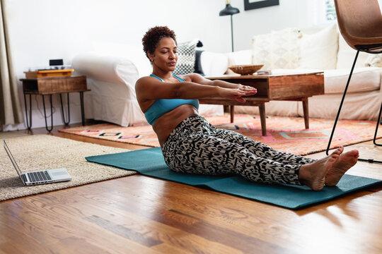 Black woman doing palates exercises