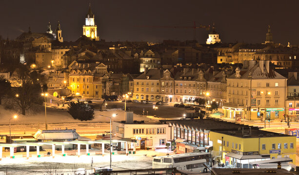 Lublin bus station against the background of the old town in winter night