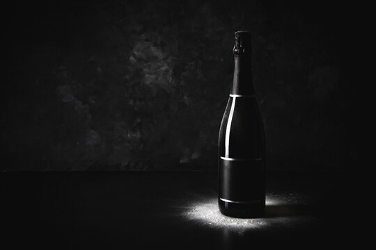 Studio shot of black bottle of champagne with blank label