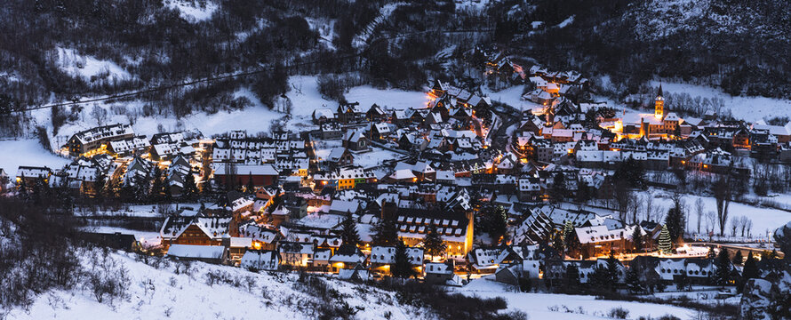 Spain, Cataluna, Baqueira, Ski resort covered with snow illuminated at dusk
