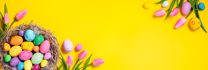 Printed kitchen splashbacks Asia Country Easter - Decorated Eggs In Nest With Pink Tulips In Yellow Background