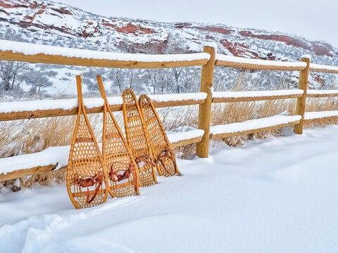 classic wooden snowshoes in winter scenery at foothills of Rocky Mountains in northern Colorado - Lory State Park