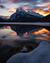 Mount Rundle reflecting in Vermilion Lakes during a fiery Winter sunrise.