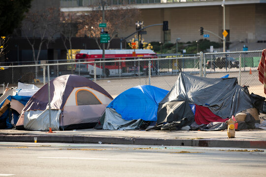 A homeless encampment sits on a street in Downtown Los Angeles, California, USA.