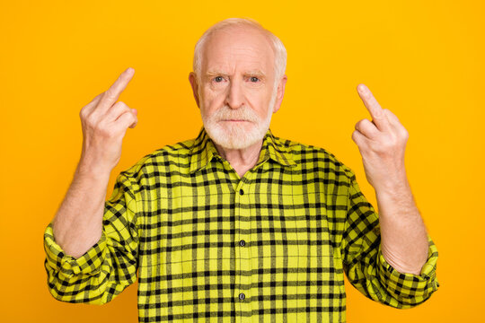 Photo of old man pensioner show fingers fucking sign rude offensive brutal isolated over yellow color background