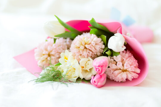 Beautiful bouquet of spring fragrant flowers tulips and hyacinths on a white background. Postcard