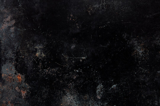 Black, old and corroded metal texture background with scratches