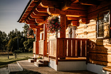 Obraz Wooden cottage in nature in sunny day. Recreation center in the mountains. Modern eko hausing in nature. Detail - fototapety do salonu