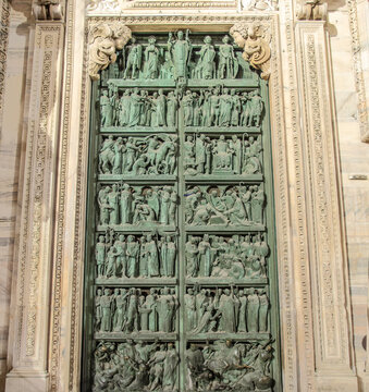 bronze door of the Duomo made by the sculptor Giannino Castiglioni concerning the religious works of St. Ambrose bishop. Milan, Italy.