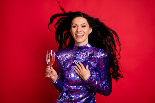 Photo of charming stunning lady nice smile fly hair hold champagne glass hand chest isolated on red color background