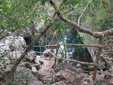 steps down to a tectonic break next to the Sendero Enigma de las Rocas hiking trail in Cienaga de Zapata, Cuba, November