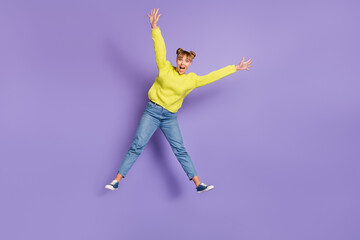 Wall Mural - Full length body size view of attractive cheerful crazy girl jumping having fun fooling isolated on bright violet color background