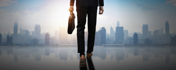 Fototapeta forward to success, back of confident businessman holding business document bag walk to achievement, future professional man leader move and step  to freedom of city and social obraz