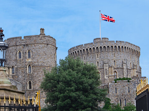 Round Tower and gilded entrance gates of Windsor Castle, England