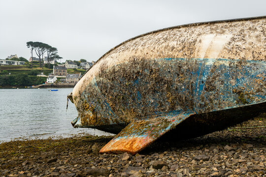 Old sailing yacht lying on ground